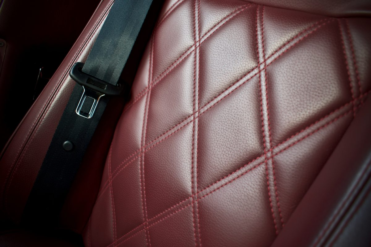 Plus Four burgundy leather interior