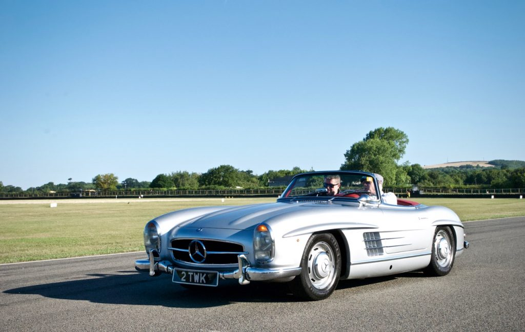 1957 Mercedes 300SL on track at Goodwood race circuit