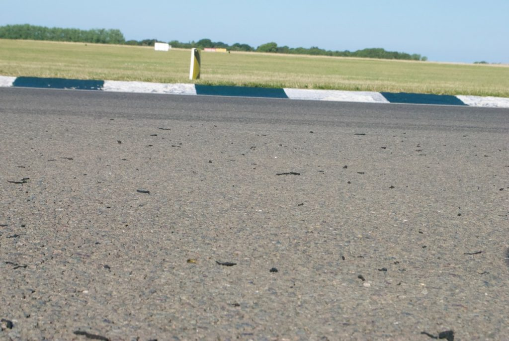 Shredded tyre on track at Woodcote, Goodwood circuit